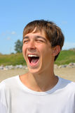 Happy teenager. On the beach Stock Image