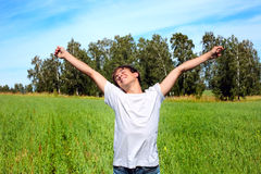 Happy teenager. Stand on the summer field Stock Image