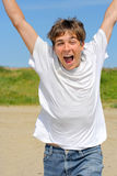 Happy teenager. Running on the beach Stock Image