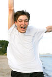 Happy teenager. On the beach Stock Images