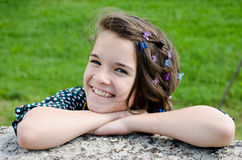 Happy teenager. With butterflies clips in the hair Royalty Free Stock Images