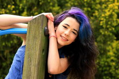 Happy teenager. Pretty young girl, with blue and purple hair Royalty Free Stock Images