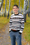 Happy teenager. Smiling teenager stand in autumn park Stock Photo