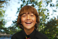 Happy Teenager. Smiling teenager dressed up in a black shirt and tie Royalty Free Stock Photography