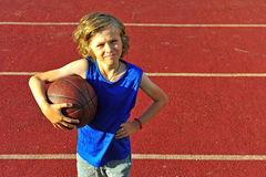 Happy teenager basketball player on court Royalty Free Stock Photo