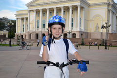 The happy teenager by bicycle near the Tyumen drama theater. Stock Photography