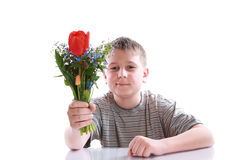 Happy teenager with bouquet of flowers Stock Photography