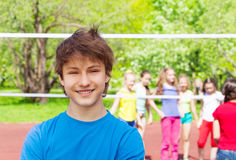 Happy teenager boy on playground during volleyball Stock Image