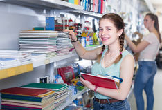 Happy teenager buying products in stationery shop. Happy teenager buying different products in stationery shop Stock Photography