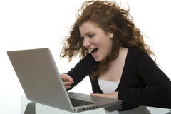 Happy teenager with computer Stock Photography