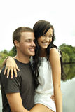 Happy teenager couple by river Stock Images
