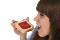 Happy teenager eat healthy toast for breakfast Stock Images