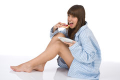Happy teenager eating healthy toast for breakfast Stock Image