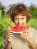 Happy teenager eating watermelon Royalty Free Stock Photography