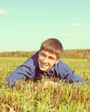 Happy Teenager in the Field. Toned Photo of Happy Teenager in the Autumn Field Stock Image