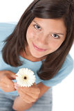Happy teenager with gerber daisy Royalty Free Stock Photos