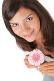 Happy teenager with gerber daisy Stock Photo