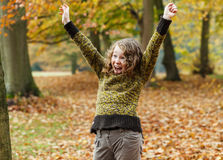 Happy teenager girl in autumn park. Happily excited teenager girl in an autumn park Stock Photo