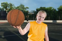 Happy teenager girl with basketball Stock Images
