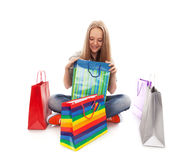 The happy customer. Happy teenager girl with bright shopping  bags Royalty Free Stock Photography