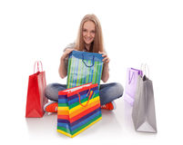 The happy customer. Happy teenager girl with bright shopping  bags Royalty Free Stock Photos