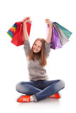 The happy customer. Happy teenager girl with bright shopping  bags stock image