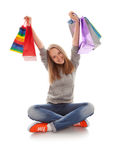 The happy customer. Happy teenager girl with bright shopping  bags royalty free stock images