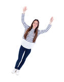 Happy teenager girl celebrating something leaving her hands Stock Photography