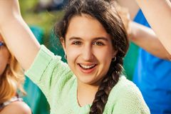 Happy teenager girl cheer for the team during game Stock Photography