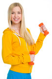 Happy teenager girl with dumbbells Royalty Free Stock Images