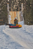 Happy teenager girl on a fast Sleigh Ride Royalty Free Stock Photos
