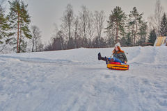 Happy teenager girl on a fast Sleigh Ride Royalty Free Stock Photography