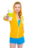Happy teenager girl giving coffee cup Royalty Free Stock Images