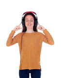 Happy teenager girl with headphones listening music Royalty Free Stock Photography