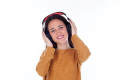 Happy teenager girl with headphones listening music Royalty Free Stock Image