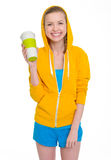 Happy teenager girl holding coffee cup Stock Photo