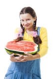 Happy teenager girl holding half of watermelon Royalty Free Stock Photos