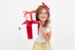 Happy Teenager Girl In A Skirt Holds Gifts On A White Background Royalty Free Stock Images
