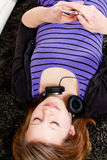 Happy teenager girl listening to music Stock Photos