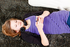 Happy teenager girl listening to music Stock Image