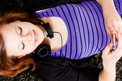Happy teenager girl listening to music royalty free stock image