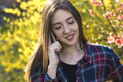 Happy teenager girl make phone call Royalty Free Stock Image
