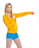 Happy teenager girl making exercise with dumbbells Stock Photo