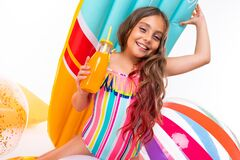 Free Happy Teenager Girl On Summer Vacation By The Sea With Swimming Circles Isolated On White Background Royalty Free Stock Photo - 182559295
