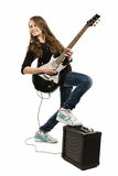 Happy teenager girl playing guitar. Teenager girl playing guitar against white background Royalty Free Stock Photos