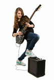 Happy teenager girl playing guitar. Teenager girl playing guitar against white background Stock Photos