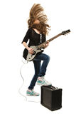 Happy teenager girl playing guitar Royalty Free Stock Image