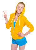 Happy teenager girl showing victory gesture Stock Images