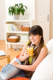 Happy teenager girl sitting home on sofa Royalty Free Stock Photo