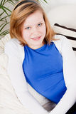 Happy teenager girl smiling sitting on couch Royalty Free Stock Photos